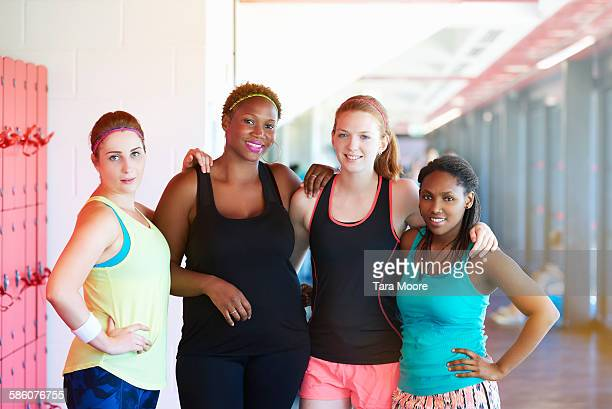 Group of sportswomen at the gym working out