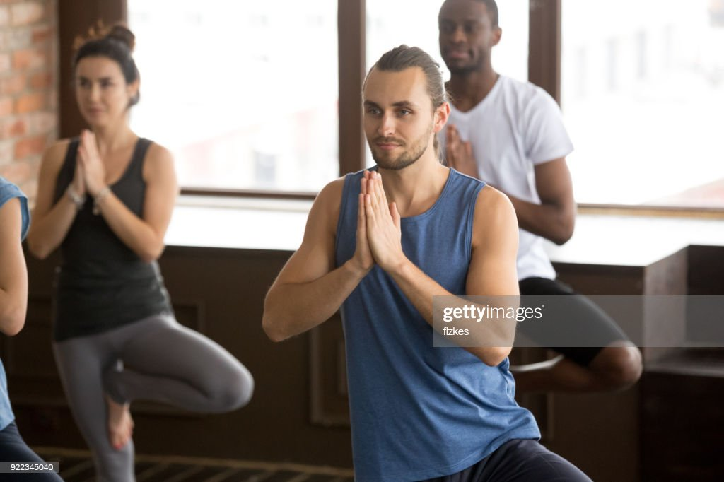 Group of sporty people in Tree pose : Stock Photo
