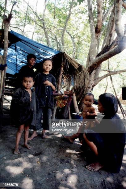 A group of starving Cambodians in a Khmer Rouge village along the border with Thailand