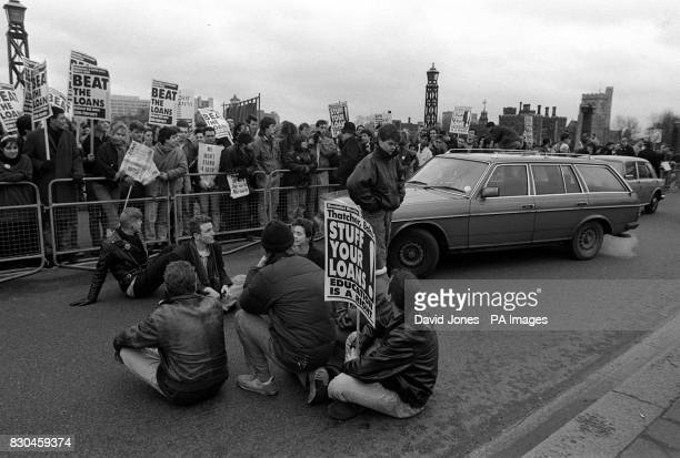 A group of stragglers stage a sitdown protest on Lambeth Bridge London during a march by students from all over the country demonstrating their...