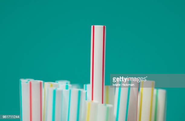 group of straws with one sticking up in the middle, objects being banned by some countries. - drinking straw stock pictures, royalty-free photos & images