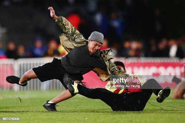 A group of streakers invade the field of play during the 2017 Rugby League World Cup match between the New Zealand Kiwis and Samoa at Mt Smart...