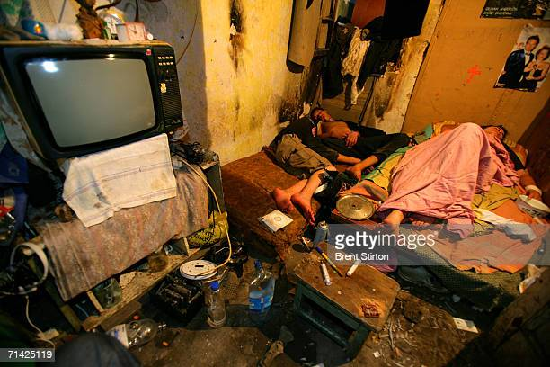 A group of street kids sleep in a filthy squat in a condemn house on August 21 2005 in Odessa Ukraine All 6 of the boys who live in the squat are HIV...