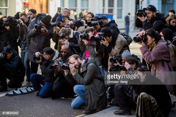 A group of street style photographers shooting outside JW Anderson during London Fashion Week February 2018 on February 17 2018 in London England