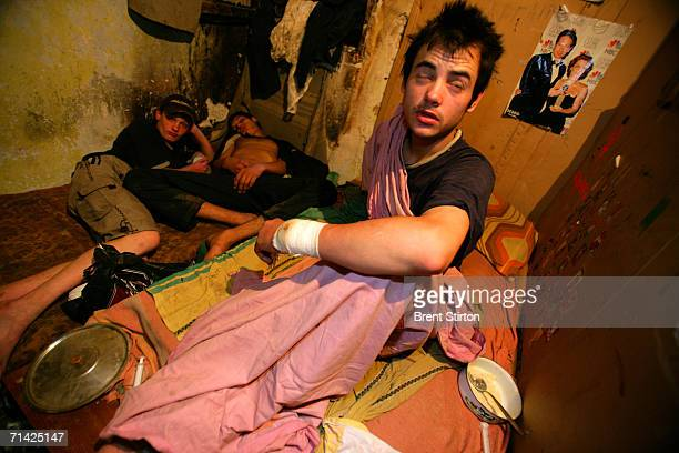 A group of streetkids sleep in a filthy squat in a wrecked unsafe house on August 21 2005 in Odessa Ukraine All 6 of the boys who live in the squat...