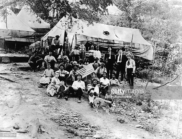 A group of striking union miners pose outdoors in the Lick Creek District of West Virginia April 12 1922 A woman holds an American flag