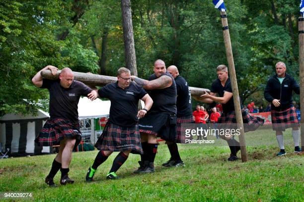 group of strong men athletes competing at scottish Highland Games