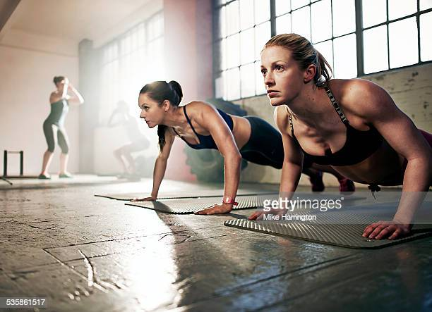 group of strong women working out in gym - concentration stock pictures, royalty-free photos & images