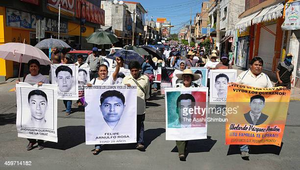 A group of students and teachers demanding justice for the 43 students missing in Iguala Guerrero hold a demonstration on November 272014 in...