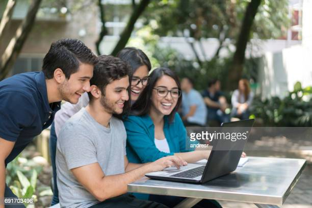 Group of students at the university using a laptop computer
