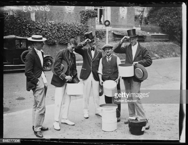 A group of students from Harrow collect their top hats from Danny Hill on Speech Day in London 1924