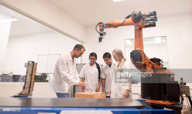 group of students in a mechatronics class - mechatronics stock pictures, royalty-free photos & images
