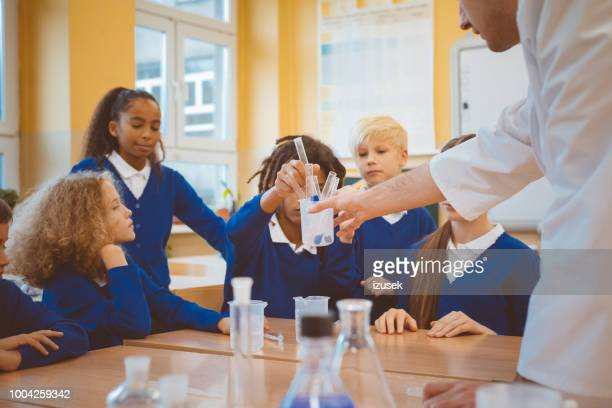 group of students in chemistry practical lab class - izusek stock pictures, royalty-free photos & images