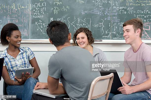 Group of students (16-18 years) in classroom laughing