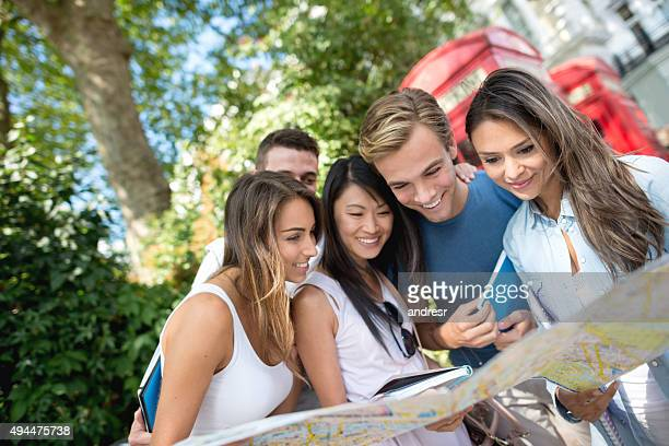 Group of students in London holding a map