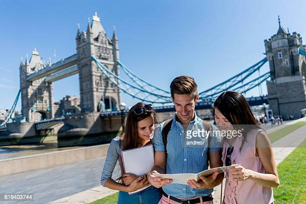 group of students in london - london bridge england stock pictures, royalty-free photos & images