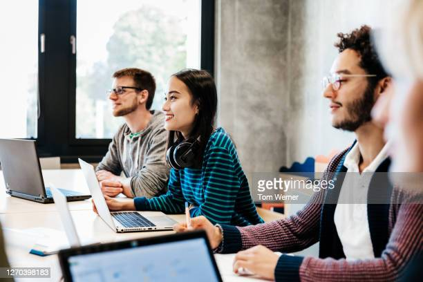 group of students listening during university seminar - education stock pictures, royalty-free photos & images