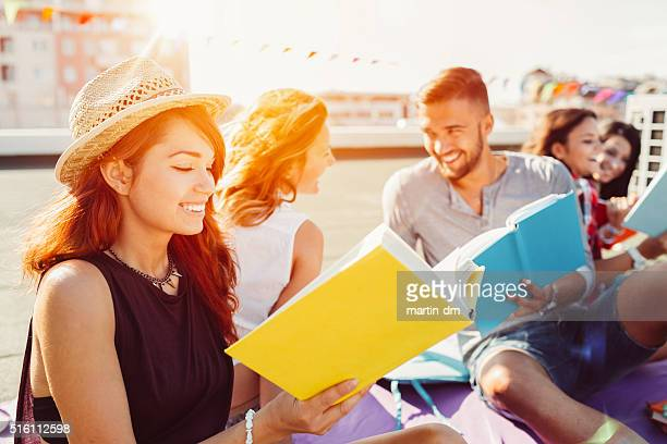 Group of students reading books on the rooftop