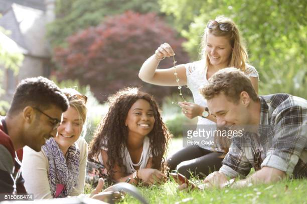 Group of students relaxing in park