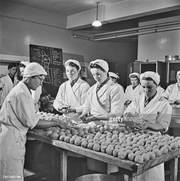 Group of students roll fishcakes made with salmon, herring and potatoes in a kitchen at a British Army Catering Corps training centre in England...