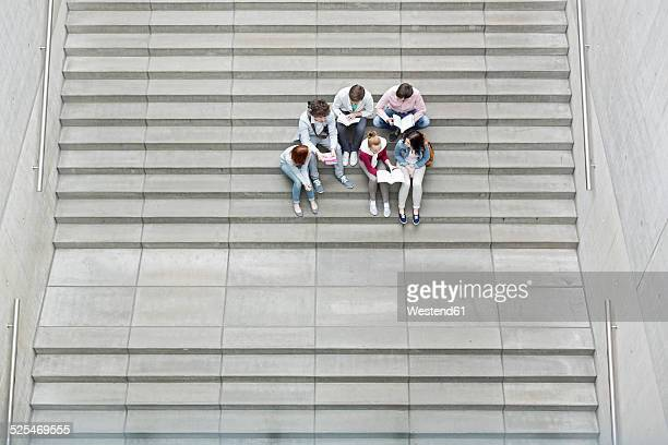 Group of students sitting on stairs
