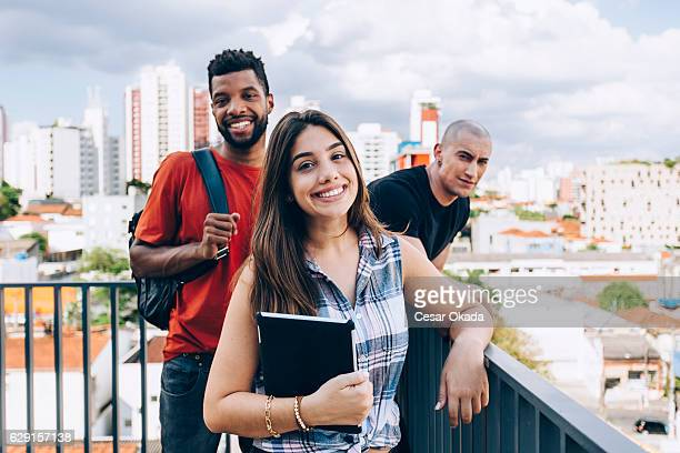 group of students smiling - brazilian men stock photos and pictures