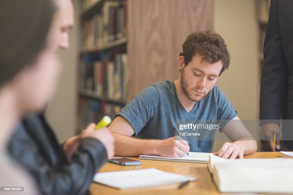 Group of students study diligently in university library : Stock Photo