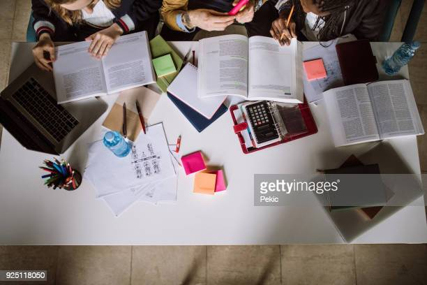 group of students studying together in reading room - preparation stock pictures, royalty-free photos & images