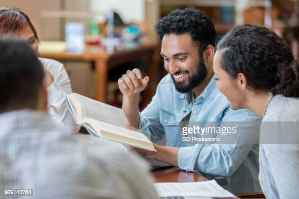 group of students studying together - book club meeting stock pictures, royalty-free photos & images
