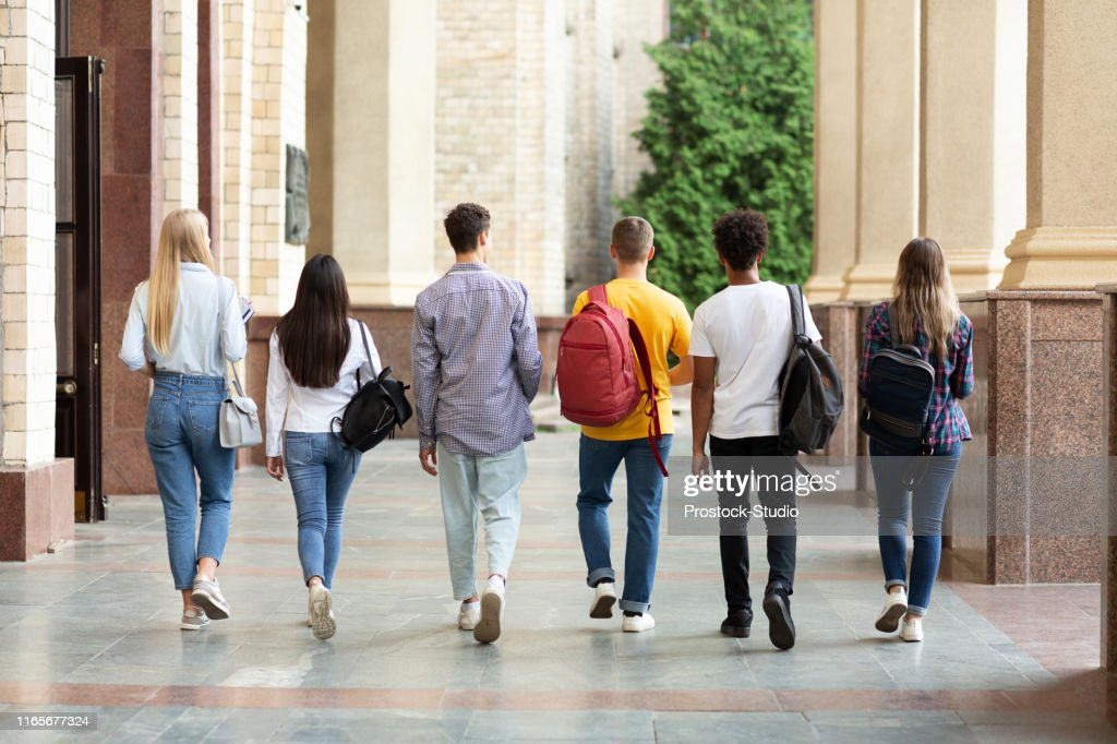 Group of students walking in college campus after classes : Stock Photo