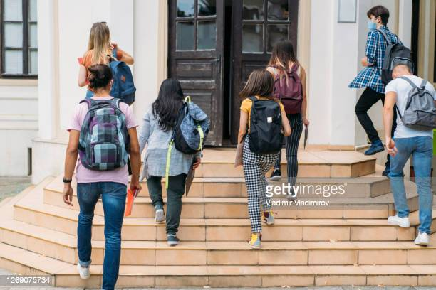 group of students walking in college - reopening stock pictures, royalty-free photos & images