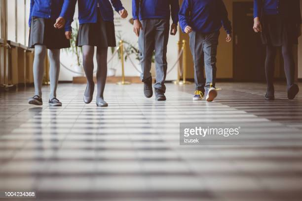 group of students walking through school hallway - unrecognizable person stock pictures, royalty-free photos & images