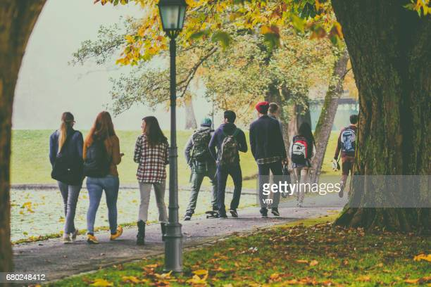 group of students walking through the park - high school musical: the musical: the series stock pictures, royalty-free photos & images