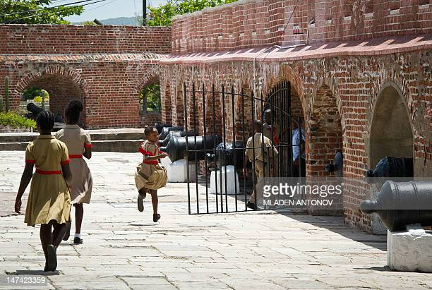 A group of students walks into Fort Charles museum in Port Royal outside Kingston on June 29 2012 Jamaica will celebrate its 50th anniversary as an...