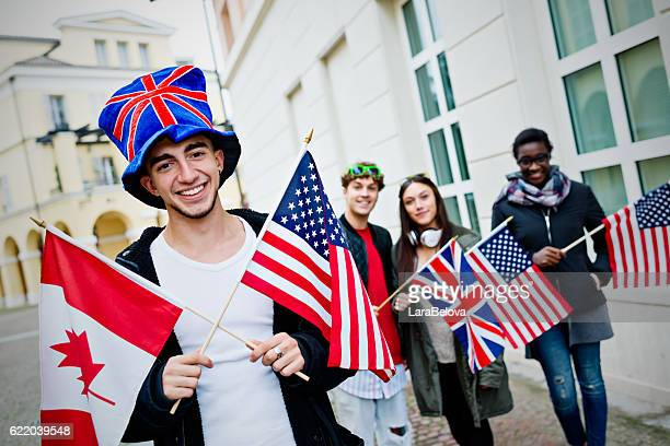 Group of students with flags of English language countries