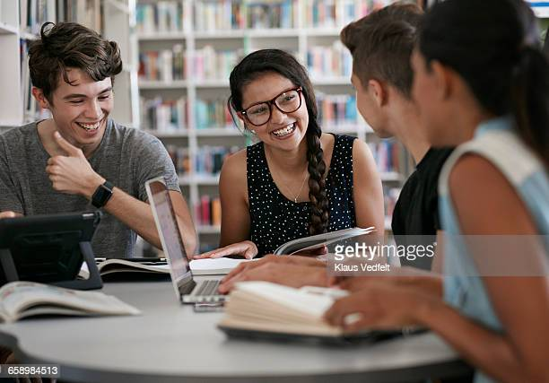 group of students working in group & laughing - college student stock pictures, royalty-free photos & images