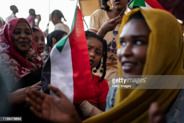 Group of Sudanese girls and women is singing during the ongoing protests against the military junta on April 26, 2019 in Khartoum, Sudan. After...
