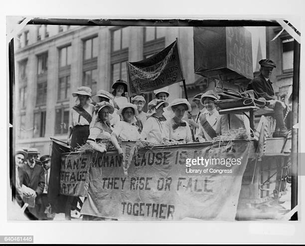 A group of suffragists ride on a wagon in the New York Fair's parade to protest for women's suffrage Yonkers New York USA