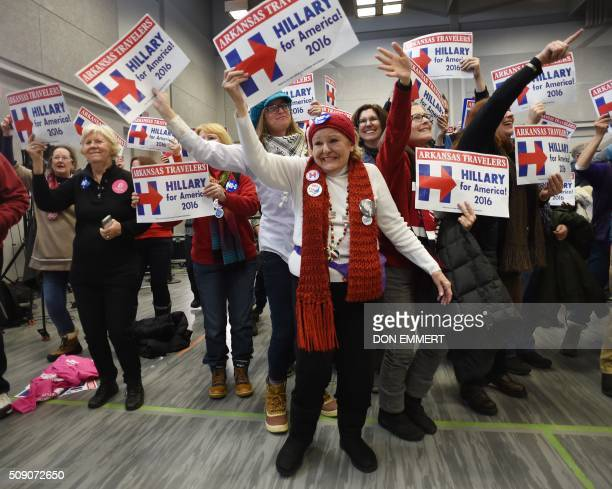 A group of supporters of democratic presidential candidate Hillary Clinton dance at a rally Manchester Community College February 8 2016 in...
