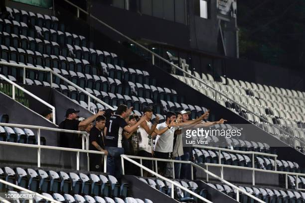 Group of supporters of Olimpia cheer for their team in the empty stands during a match between Olimpia and Defensa y Justicia as part of Copa...