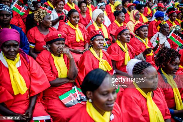 A group of supporters of ruling political party 'Jubilee' attend the independence celebrations on Jamhuri Day at Kasarani stadium in Nairobi Kenya on...