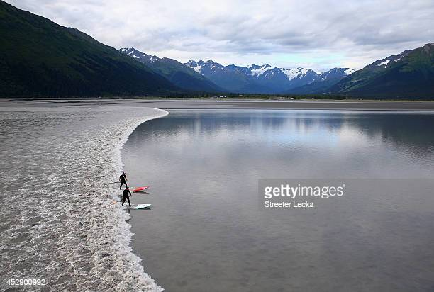 A group of surfers catch the Bore Tide near a small town called Girdwood at Turnagain Arm on July 15 2014 in Anchorage Alaska Alaska's most famous...