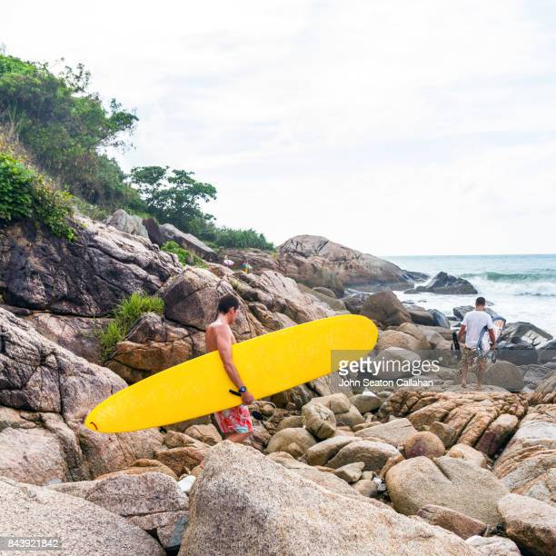 group of surfers on hainan island - hainan island stock pictures, royalty-free photos & images