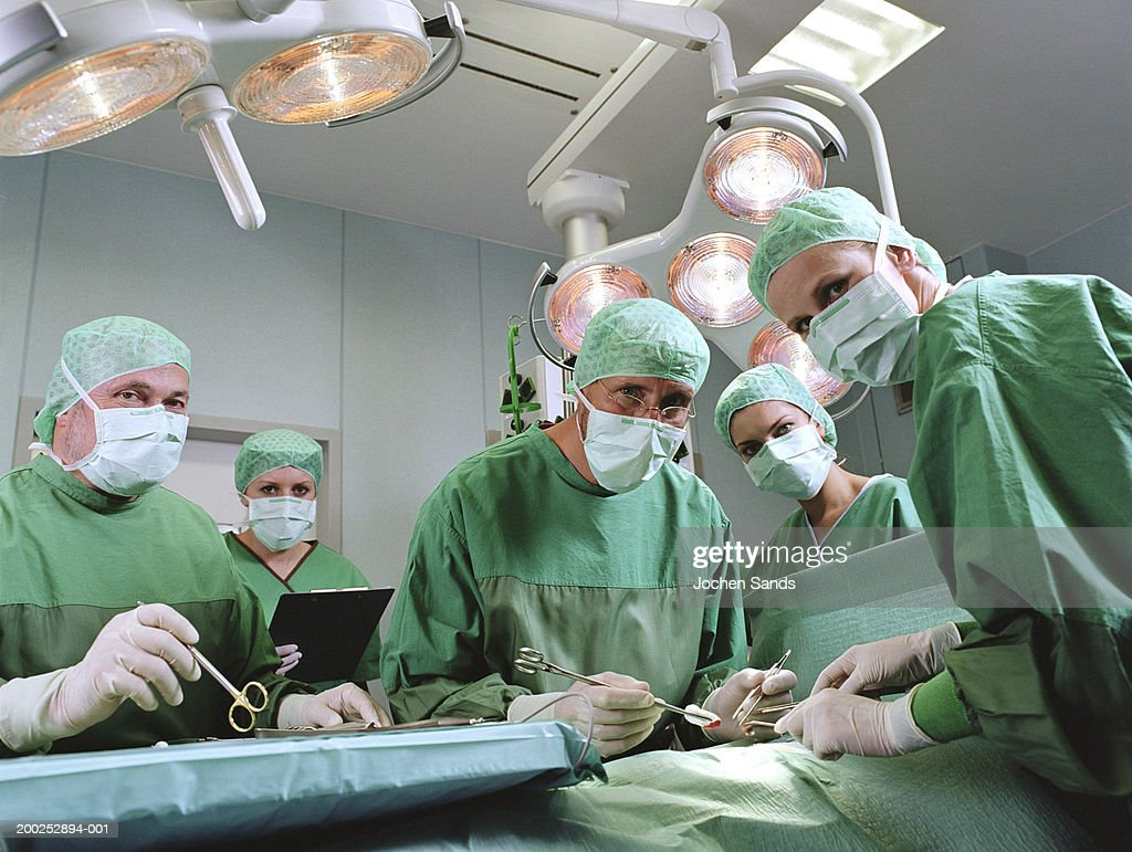 Group of surgeons in operating theatre, portrait : Stock Photo