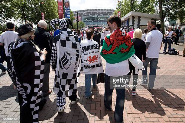 A group of Swansea City fans on Olympic Way on their way to the Npower Championship playoff final between Reading and Swansea City at Wembley Stadium...
