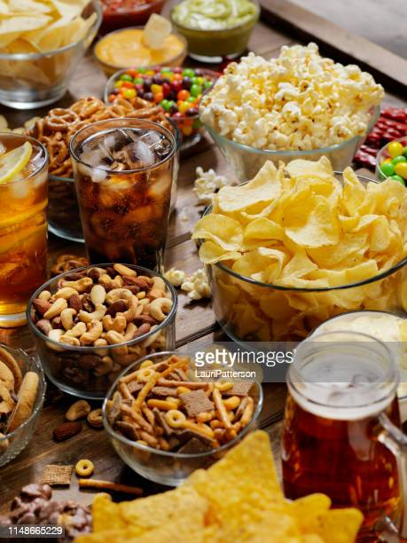 group of sweet and salty snacks, perfect for binge watching - unhealthy eating stock pictures, royalty-free photos & images