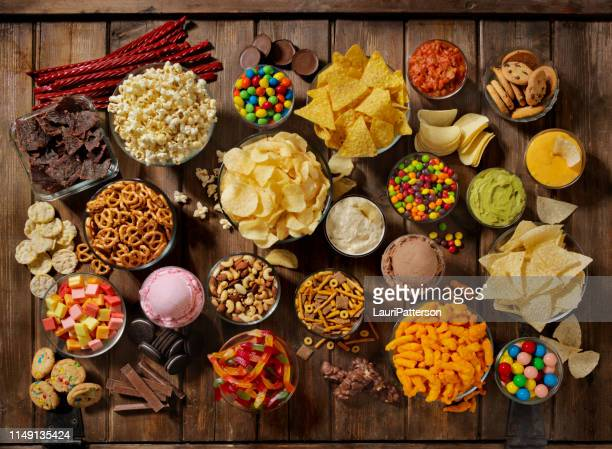 group of sweet and salty snacks, perfect for binge watching - sweet food stock pictures, royalty-free photos & images