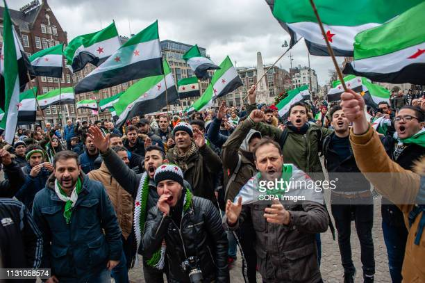 A group of Syrian are seen singing Syrians songs while holding flags during the demonstration The Syrian community in the Netherlands took the Dam...