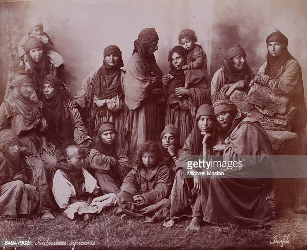 A group of Syrian bedouins wear traditional dress