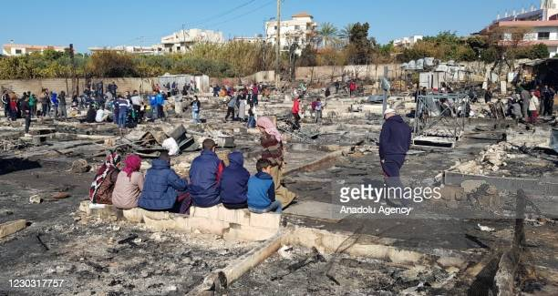 Group of Syrian refugees are seen at street after a tent camp was set fire on clashes between a group of Lebanese clash and Syrian refugees in...